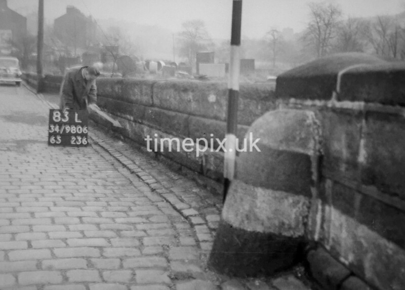 SD980683L, Man marking Ordnance Survey minor control revision point with an arrow in 1950s