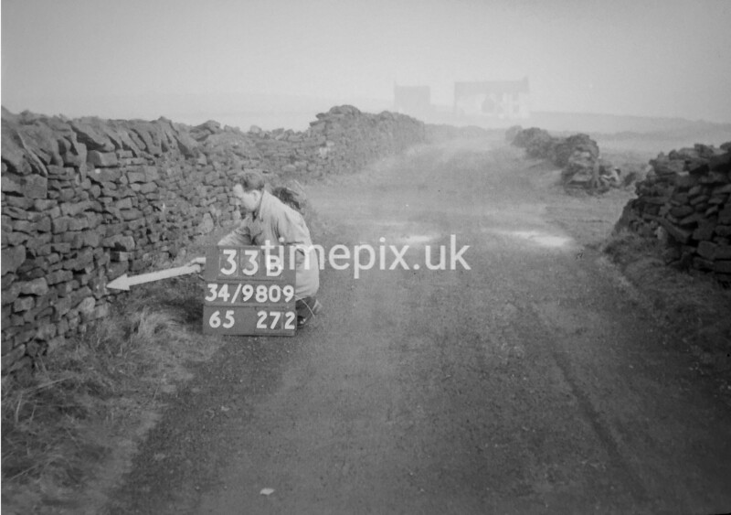SD980933B, Man marking Ordnance Survey minor control revision point with an arrow in 1950s