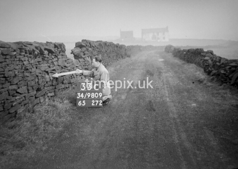 SD980933C, Man marking Ordnance Survey minor control revision point with an arrow in 1950s