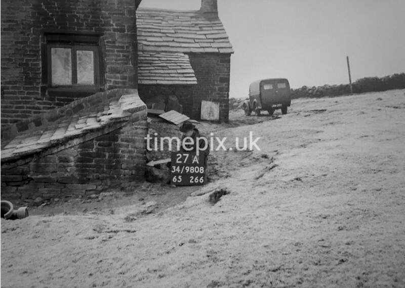 SD980827A, Man marking Ordnance Survey minor control revision point with an arrow in 1950s