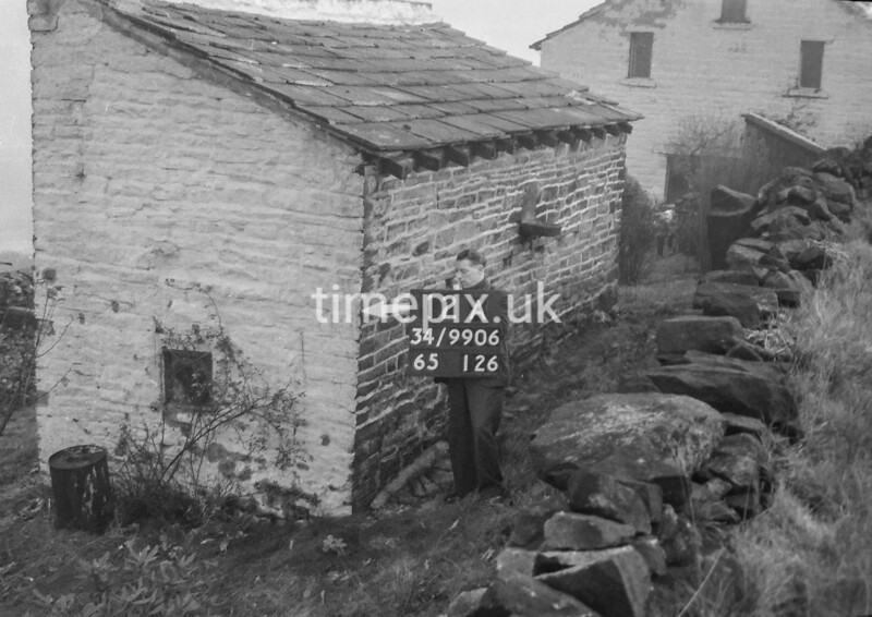 SD990612A, Man marking Ordnance Survey minor control revision point with an arrow in 1950s