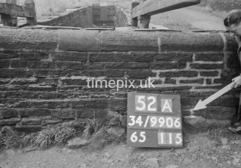 SD990652A1, Man marking Ordnance Survey minor control revision point with an arrow in 1950s