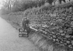 SD990667A1, Man marking Ordnance Survey minor control revision point with an arrow in 1950s