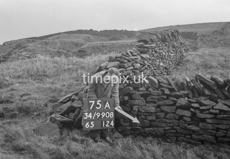 SD990875A, Man marking Ordnance Survey minor control revision point with an arrow in 1950s
