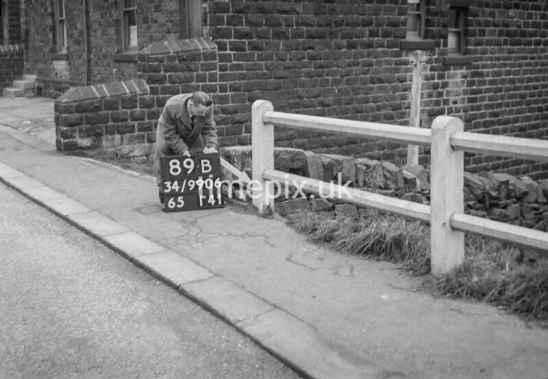 SD990689B1, Man marking Ordnance Survey minor control revision point with an arrow in 1950s
