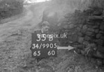 SD990535B1, Man marking Ordnance Survey minor control revision point with an arrow in 1950s