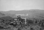 SD980588A, Man marking Ordnance Survey minor control revision point with an arrow in 1950s