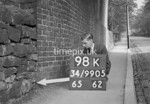SD990598K, Man marking Ordnance Survey minor control revision point with an arrow in 1950s