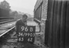 SD990596B1, Man marking Ordnance Survey minor control revision point with an arrow in 1950s
