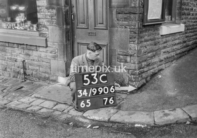 SD990653C, Man marking Ordnance Survey minor control revision point with an arrow in 1950s