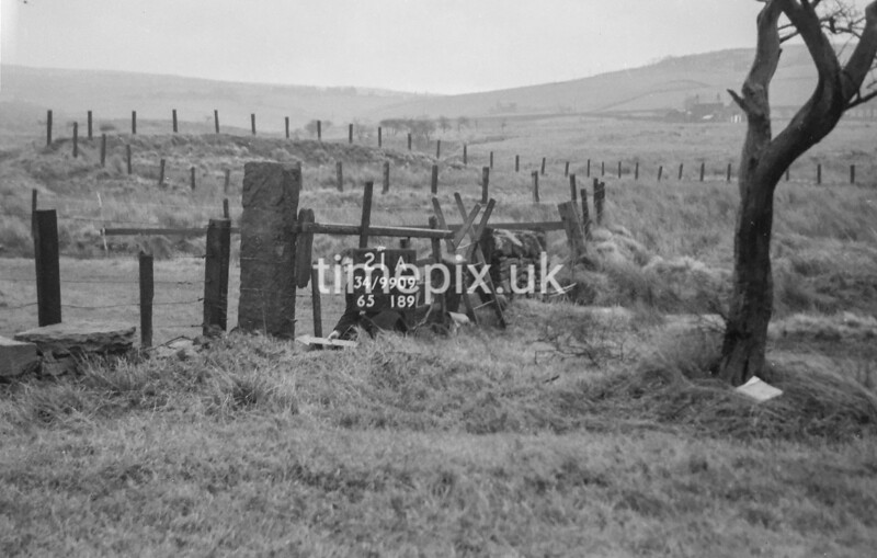 SD990921A, Man marking Ordnance Survey minor control revision point with an arrow in 1950s