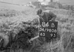 SD980884B2, Man marking Ordnance Survey minor control revision point with an arrow in 1950s