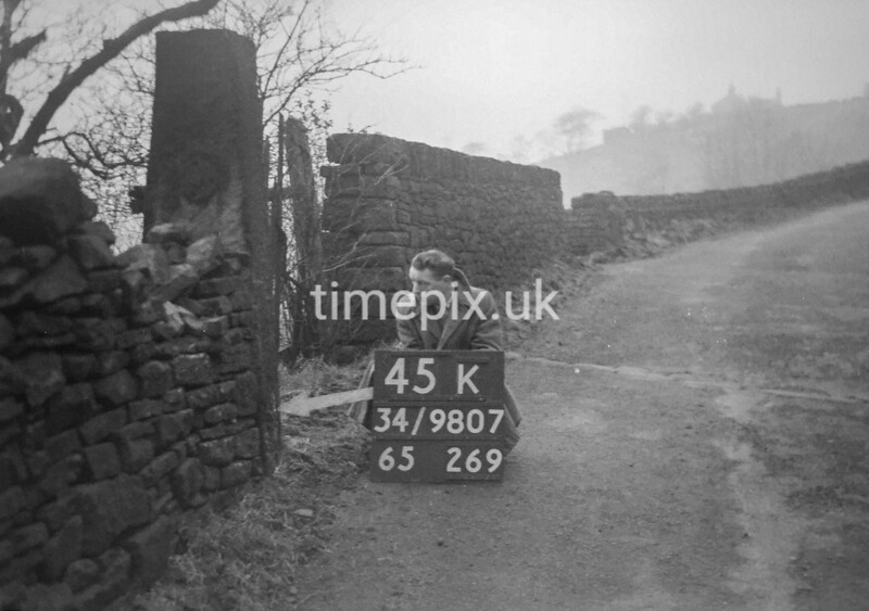 SD980745K, Man marking Ordnance Survey minor control revision point with an arrow in 1950s