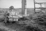 SD980552A, Man marking Ordnance Survey minor control revision point with an arrow in 1950s