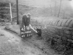 SD980642B, Man marking Ordnance Survey minor control revision point with an arrow in 1950s