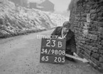 SD980823B, Man marking Ordnance Survey minor control revision point with an arrow in 1950s