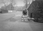 SD980785A, Man marking Ordnance Survey minor control revision point with an arrow in 1950s