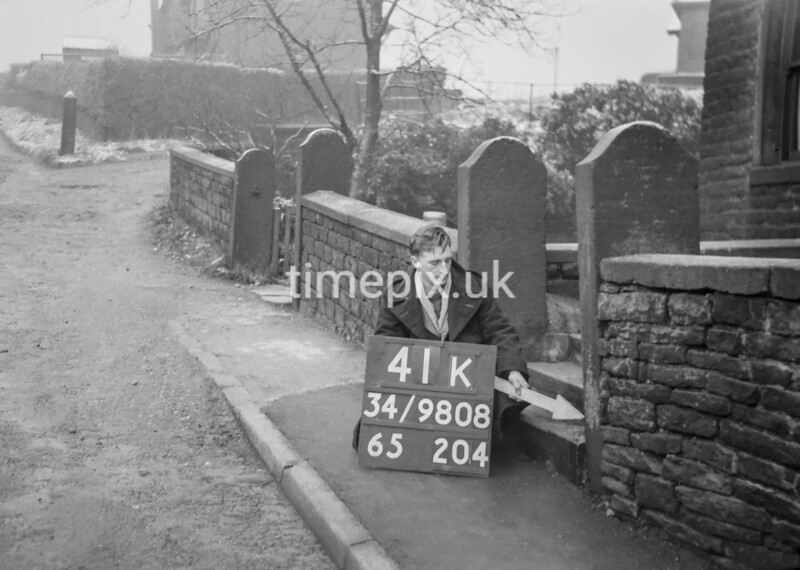 SD980841K, Man marking Ordnance Survey minor control revision point with an arrow in 1950s
