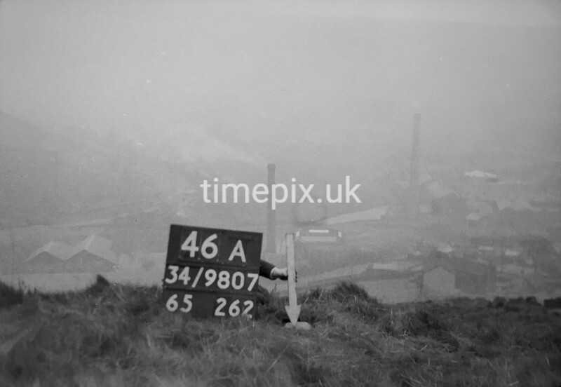 SD980746A, Man marking Ordnance Survey minor control revision point with an arrow in 1950s