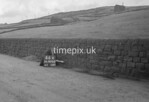 SD990846A2, Man marking Ordnance Survey minor control revision point with an arrow in 1950s