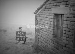 SD980846A, Man marking Ordnance Survey minor control revision point with an arrow in 1950s