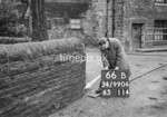 SD990666B, Man marking Ordnance Survey minor control revision point with an arrow in 1950s