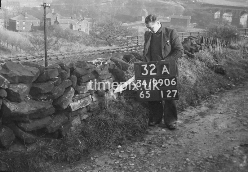 SD990632A2, Man marking Ordnance Survey minor control revision point with an arrow in 1950s