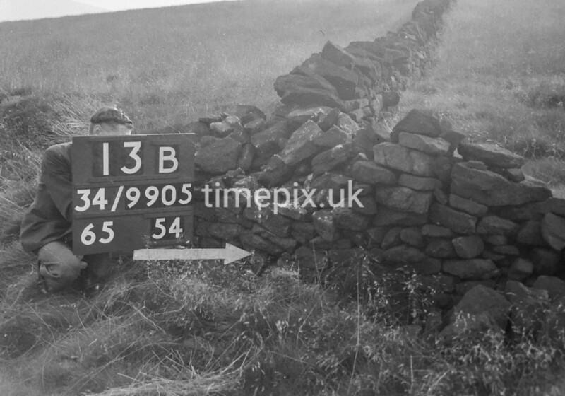 SD990513B, Man marking Ordnance Survey minor control revision point with an arrow in 1950s