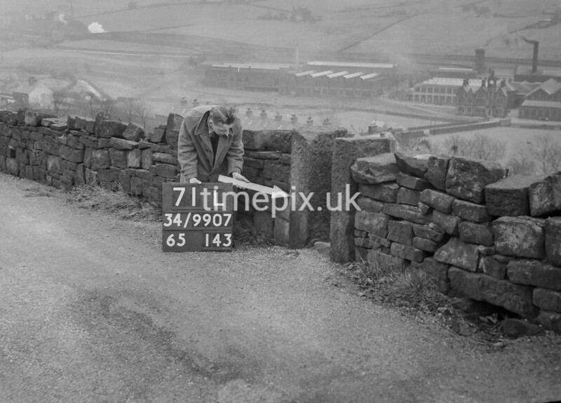 SD990771L2, Man marking Ordnance Survey minor control revision point with an arrow in 1950s