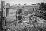 SD990592B, Man marking Ordnance Survey minor control revision point with an arrow in 1950s