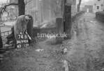 SD990674B1, Man marking Ordnance Survey minor control revision point with an arrow in 1950s