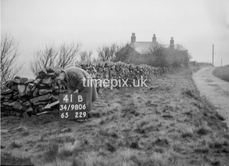 SD980641B, Man marking Ordnance Survey minor control revision point with an arrow in 1950s