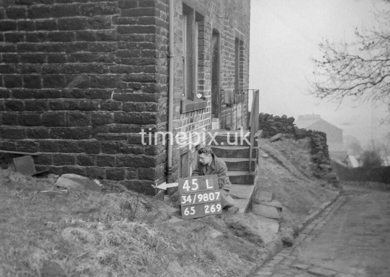 SD980745L, Man marking Ordnance Survey minor control revision point with an arrow in 1950s