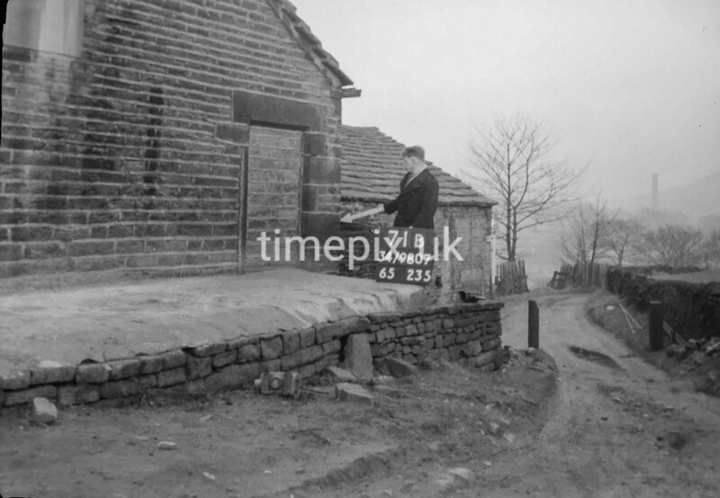 SD980771B, Man marking Ordnance Survey minor control revision point with an arrow in 1950s