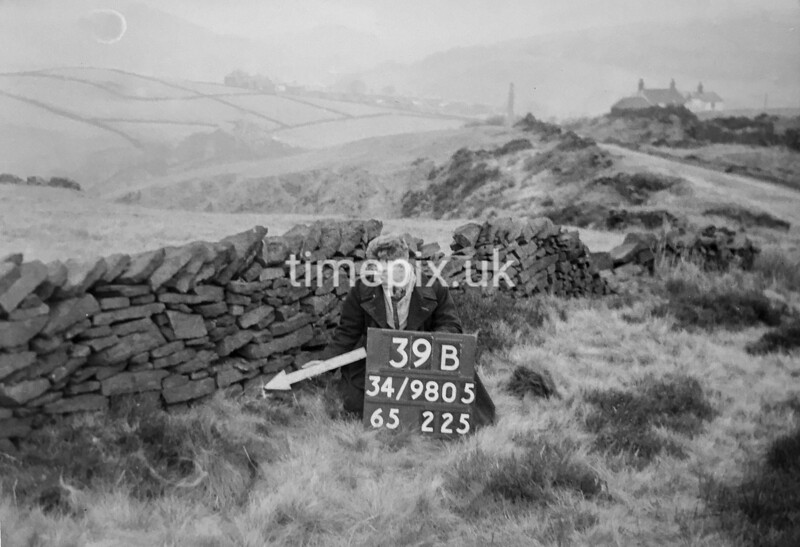 SD980539B, Man marking Ordnance Survey minor control revision point with an arrow in 1950s