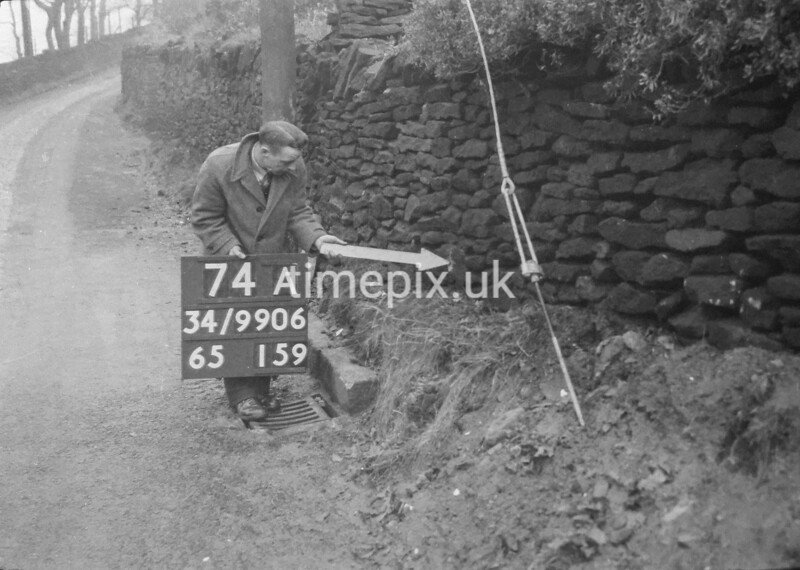 SD990674A2, Man marking Ordnance Survey minor control revision point with an arrow in 1950s