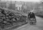 SD980797A, Man marking Ordnance Survey minor control revision point with an arrow in 1950s