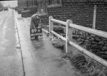 SD990689A, Man marking Ordnance Survey minor control revision point with an arrow in 1950s