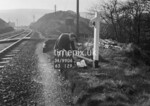 SD990671A, Man marking Ordnance Survey minor control revision point with an arrow in 1950s