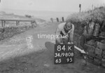 SD980884K, Man marking Ordnance Survey minor control revision point with an arrow in 1950s