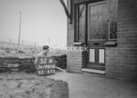 SD980852A, Man marking Ordnance Survey minor control revision point with an arrow in 1950s
