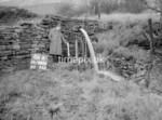 SD980686A, Man marking Ordnance Survey minor control revision point with an arrow in 1950s