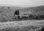 SD990910A, Man marking Ordnance Survey minor control revision point with an arrow in 1950s