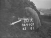 SD990720A, Man marking Ordnance Survey minor control revision point with an arrow in 1950s