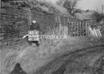 SD990665A, Man marking Ordnance Survey minor control revision point with an arrow in 1950s