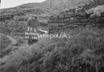 SD990771L1, Man marking Ordnance Survey minor control revision point with an arrow in 1950s