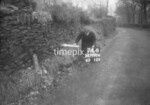 SD990674B3, Man marking Ordnance Survey minor control revision point with an arrow in 1950s