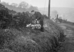 SD990612B, Man marking Ordnance Survey minor control revision point with an arrow in 1950s