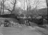 SD980796A, Man marking Ordnance Survey minor control revision point with an arrow in 1950s