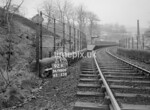 SD980692K, Man marking Ordnance Survey minor control revision point with an arrow in 1950s
